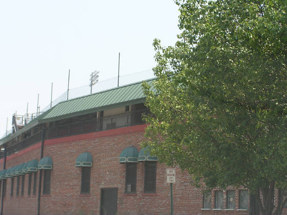 Engel Stadium's green awnings over the ticket wind